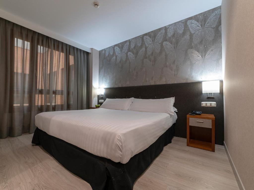 Giường trong phòng chung tại Hotel Plaza Las Matas
