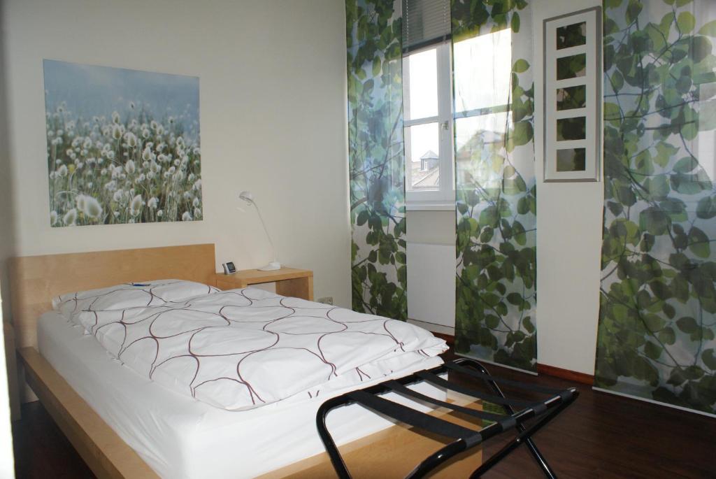 Кровать или кровати в номере Gästehaus Alte Schule