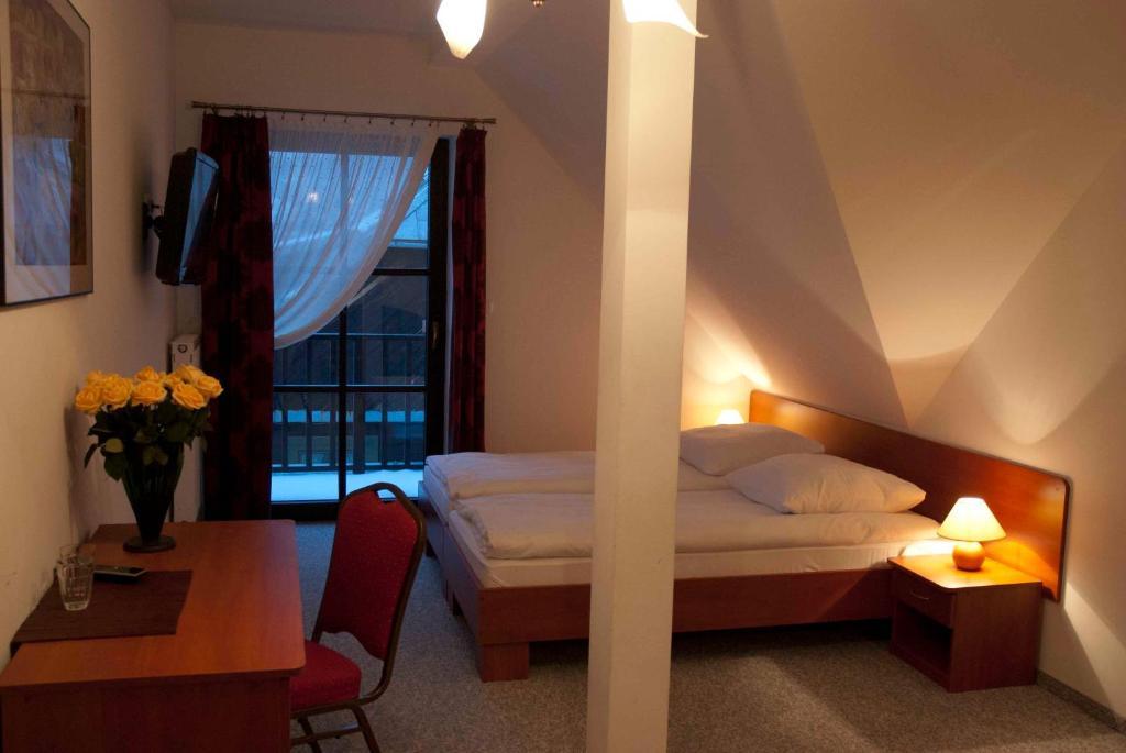 Łóżko lub łóżka w pokoju w obiekcie Willa Agnieszka