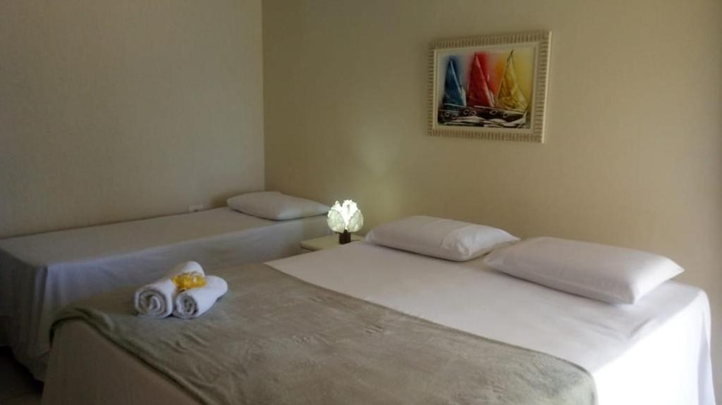 Cama ou camas em um quarto em Pousada Canto do Boldró
