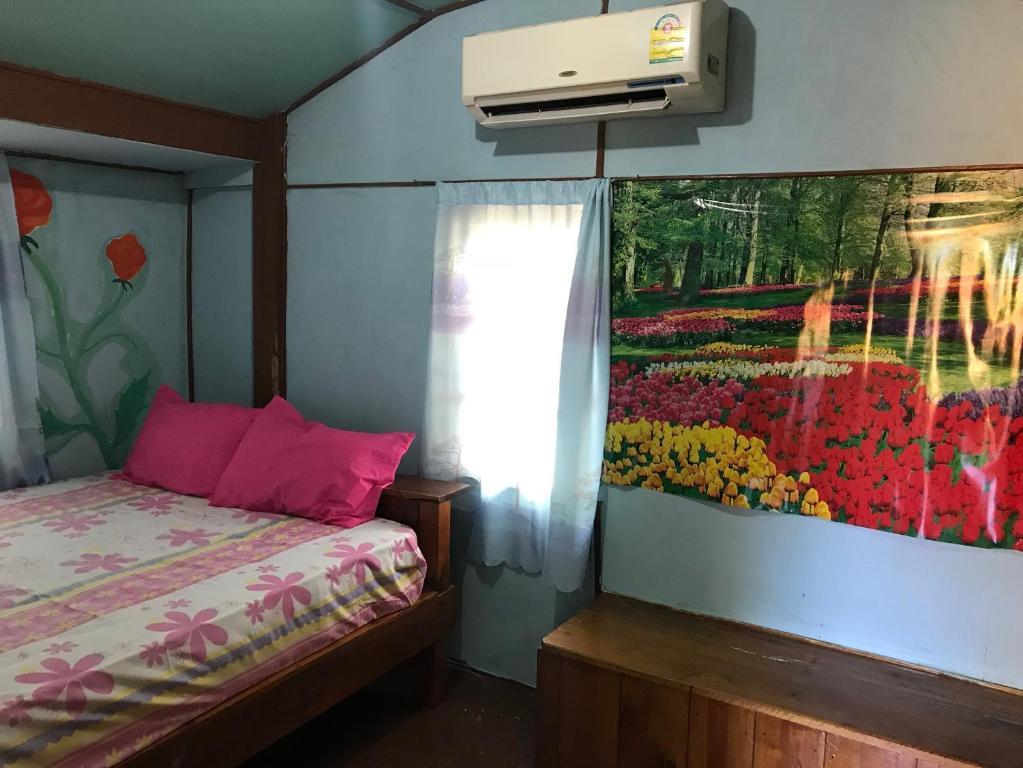 Ein Bett oder Betten in einem Zimmer der Unterkunft Koh Mak Green View Resort