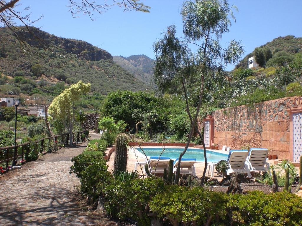 The swimming pool at or near Casa Vacacional Rural Villa Barranco de los Cernícalos