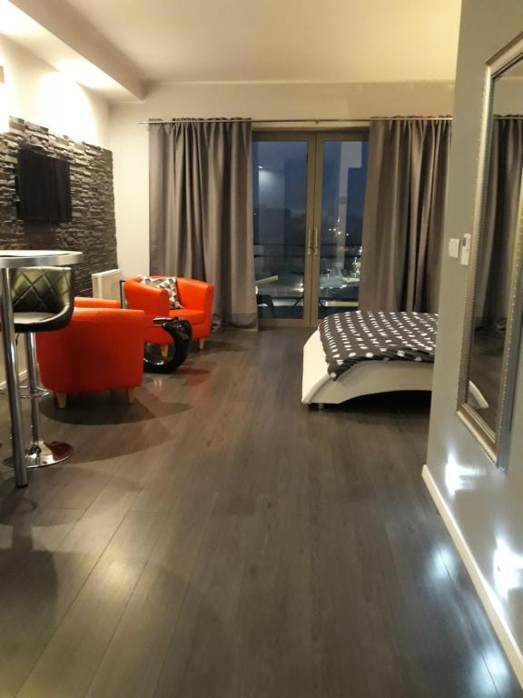 A seating area at Apartament Onyx