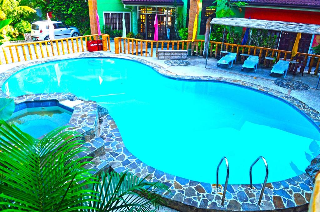 A view of the pool at Stefanie Grace Paradise Inn or nearby
