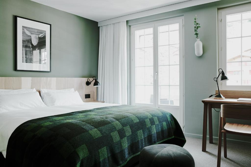 A bed or beds in a room at The Cambrian