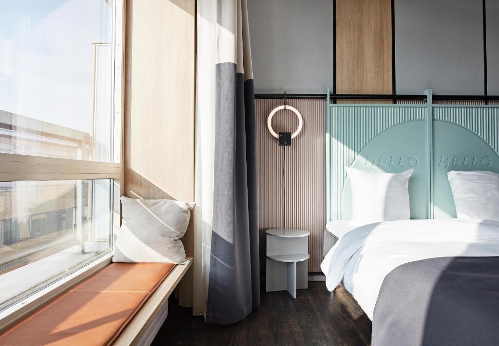 Säng eller sängar i ett rum på CPH Hotel