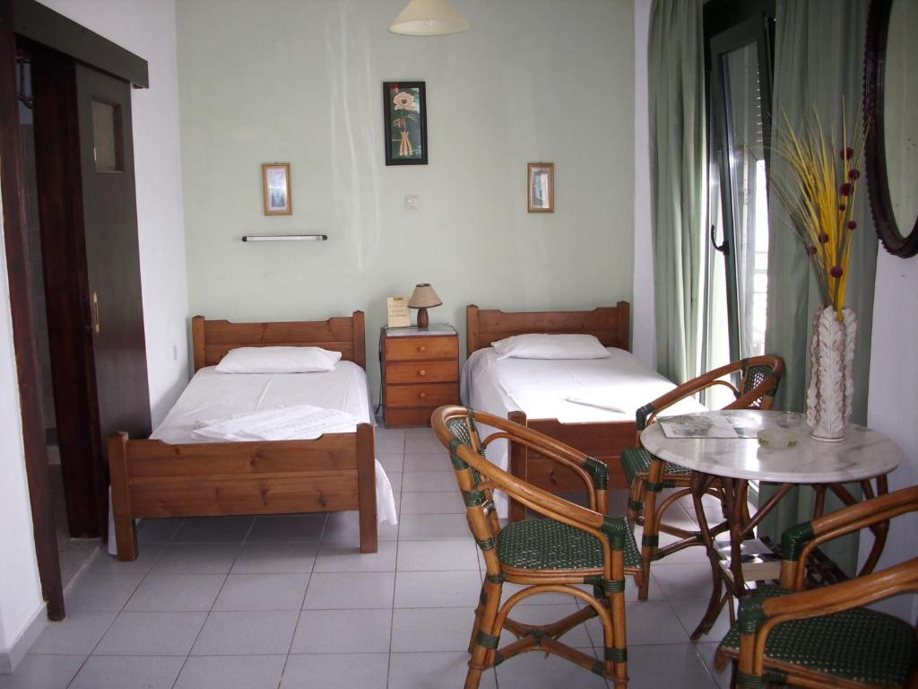 A bed or beds in a room at By Captains Studio