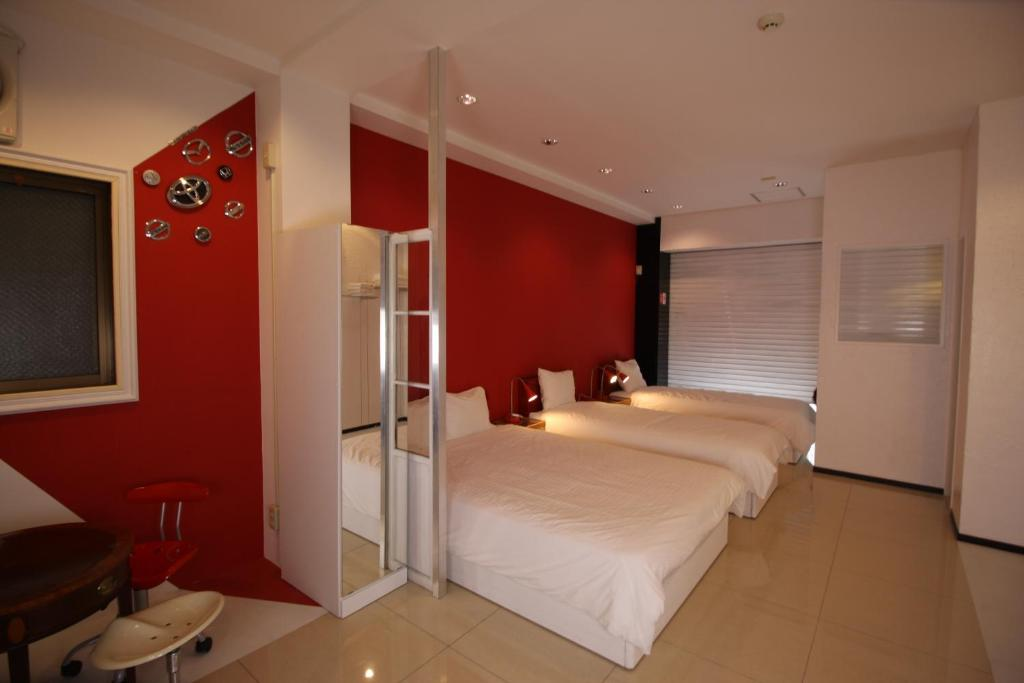 A bed or beds in a room at Vann Amor Apartment Takenotsuka