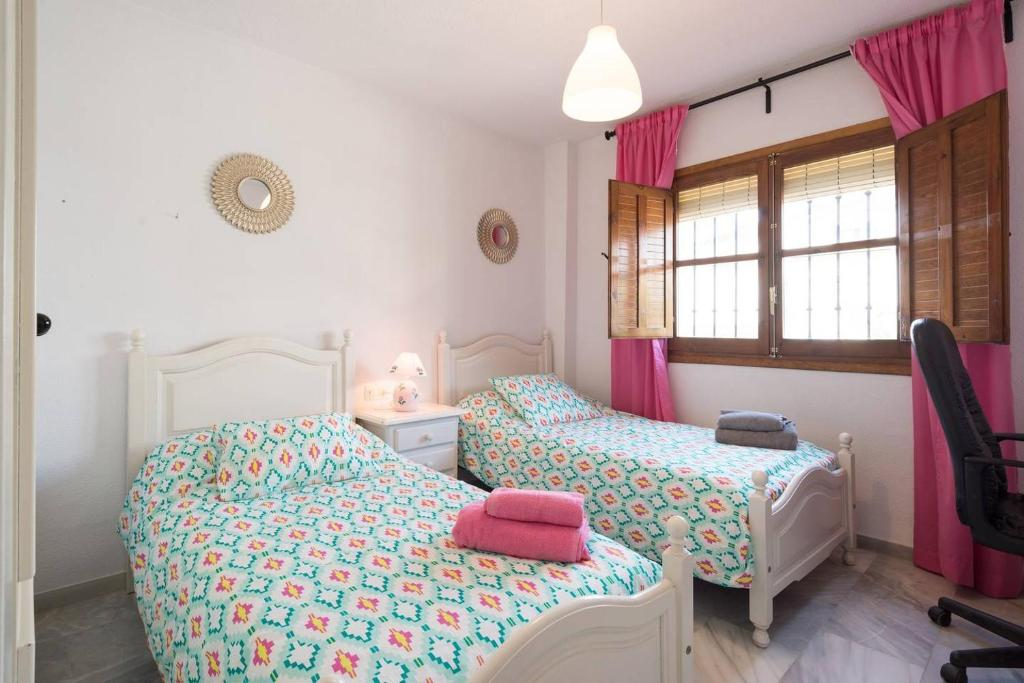 A bed or beds in a room at Casa Heliomar