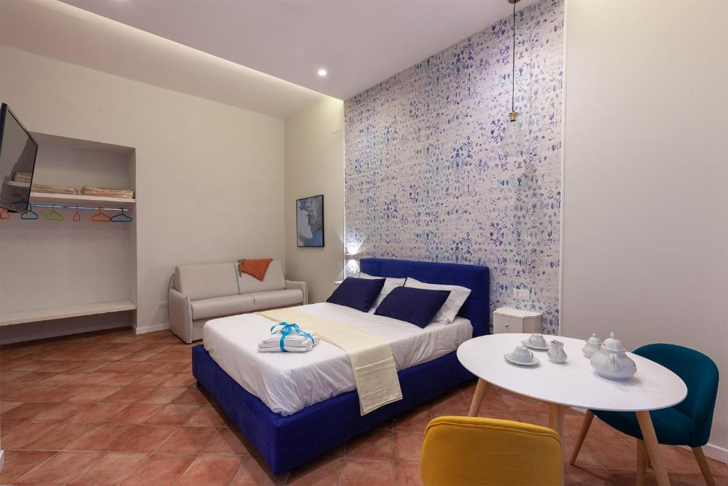 A bed or beds in a room at Mythos Holidays