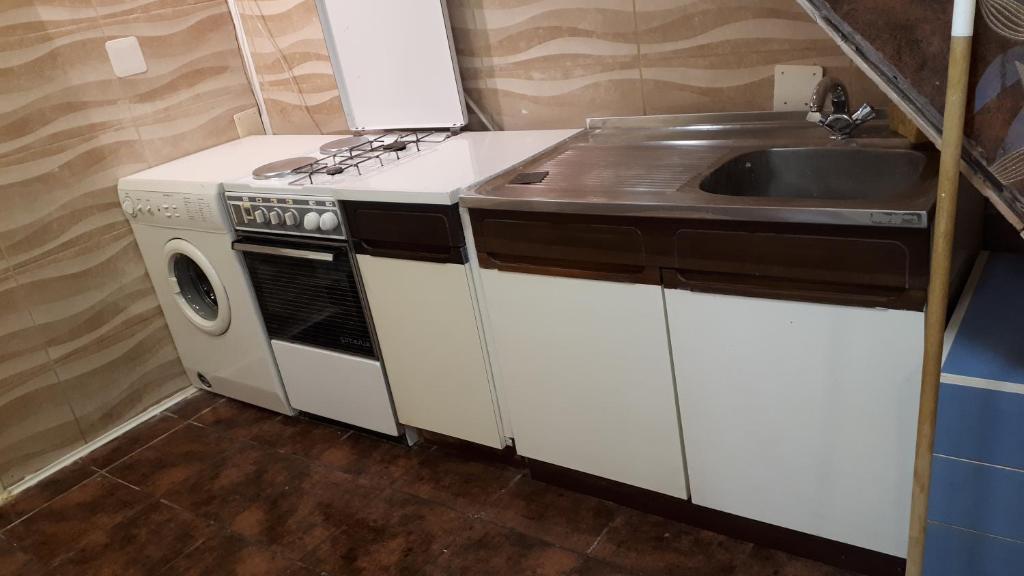 Een keuken of kitchenette bij Neno