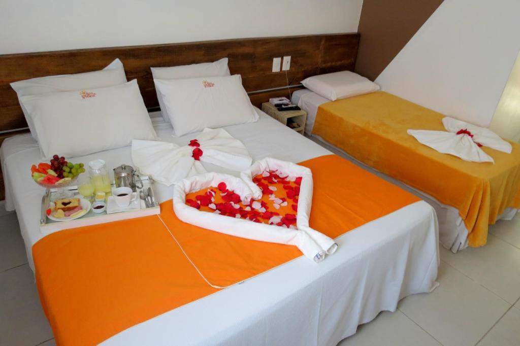 A bed or beds in a room at Hotel Encantos de Penedo Alagoas