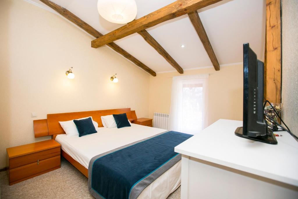 Кровать или кровати в номере Гостевой дом «Каштан»