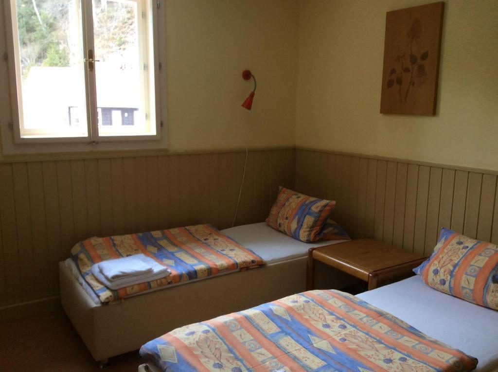 Postel nebo postele na pokoji v ubytování Turnerova chata