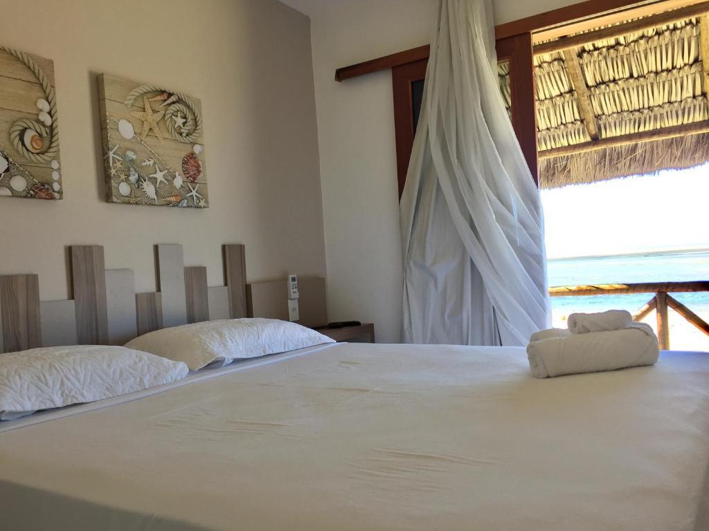 Cama ou camas em um quarto em Pousada Portal da Ilha