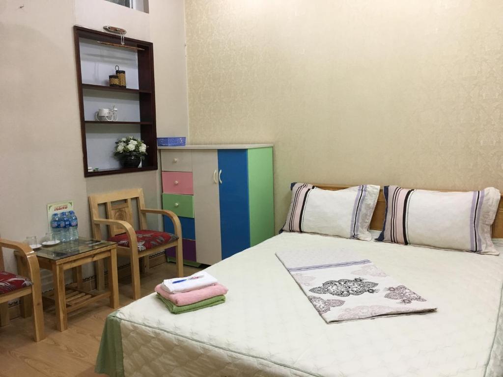 Giường trong phòng chung tại Homestay