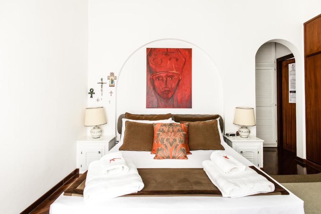 Letto o letti in una camera di Casa Valeria