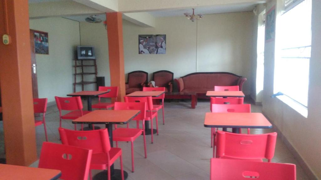 A restaurant or other place to eat at ACIF Hotel Ltd