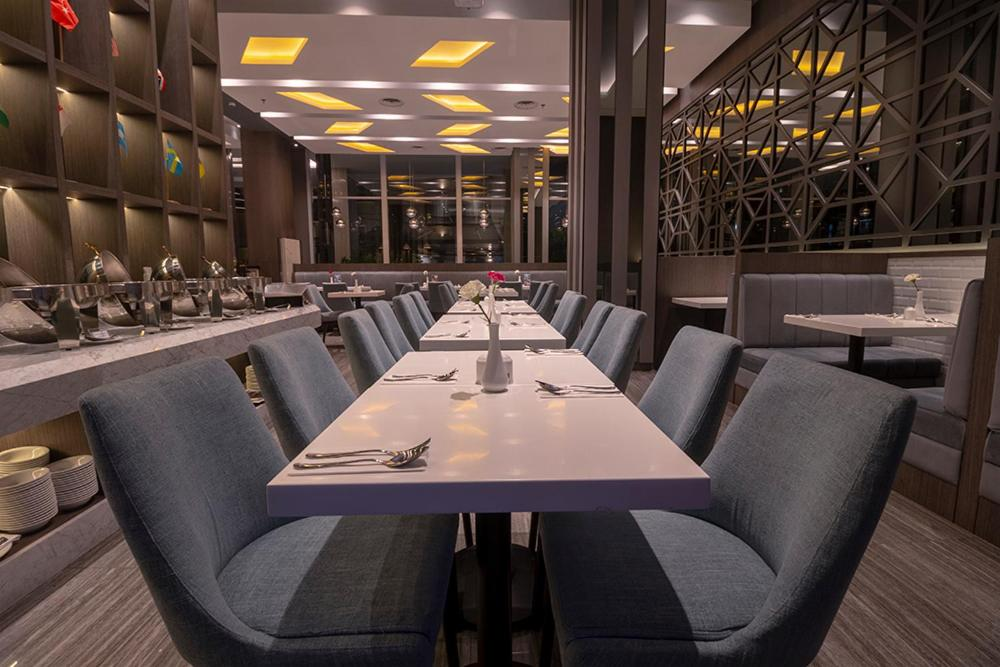 A restaurant or other place to eat at Grand Picasso Hotel