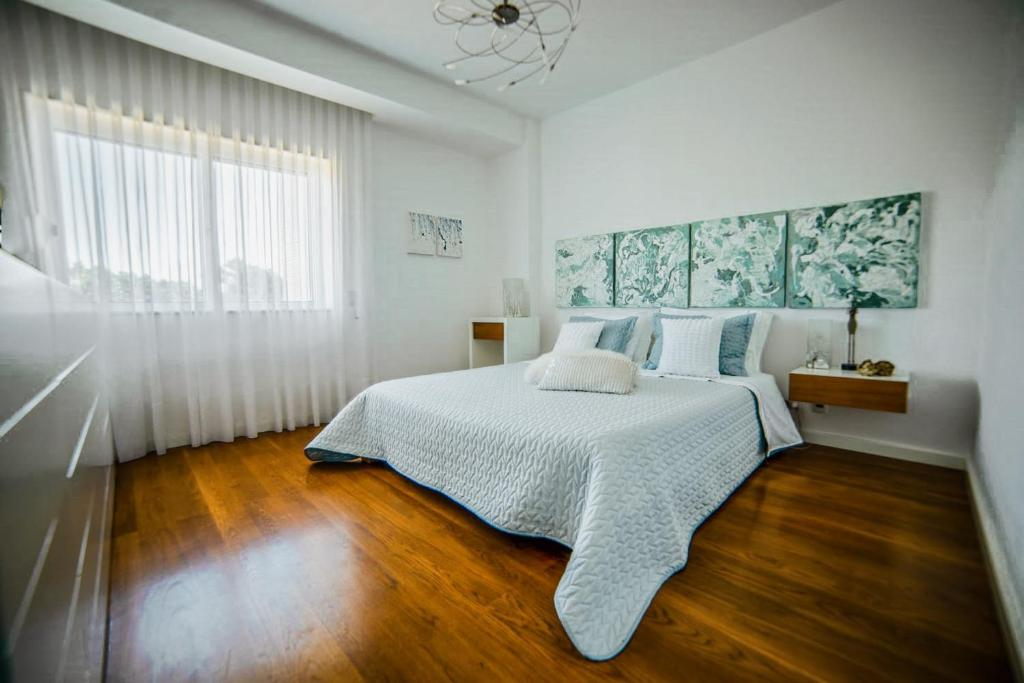 A bed or beds in a room at Terraços do Mar 1 by MP