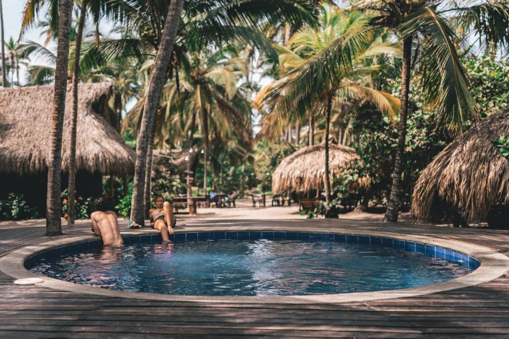 The swimming pool at or near Los Hermanos Beach Hostal
