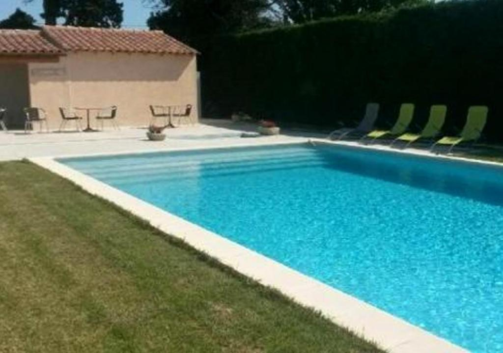 The swimming pool at or near Logis Hotel La Goutte D'eau