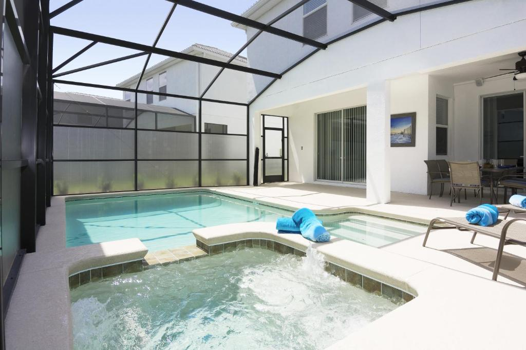 The swimming pool at or close to Dream Single Vacation Home Close to Disney SL4788