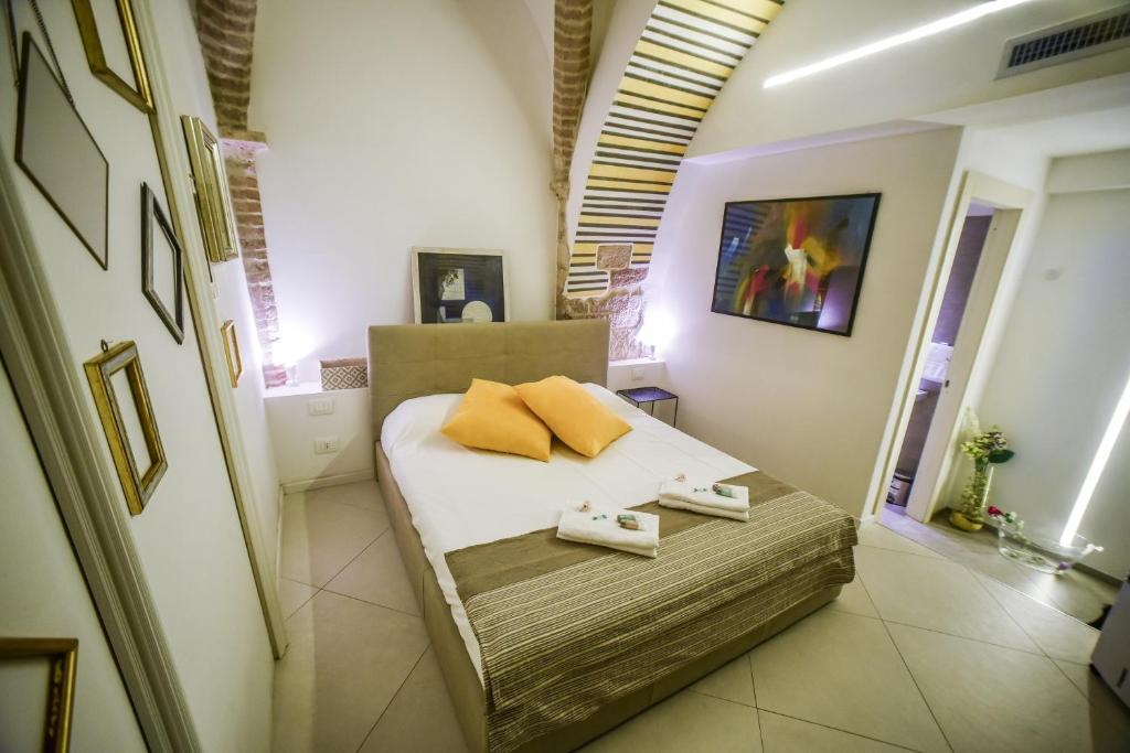 A bed or beds in a room at Little Italy Boutique Hostel