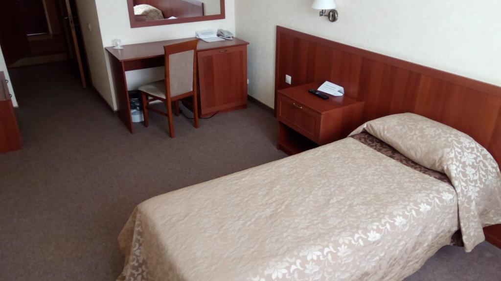 Кровать или кровати в номере Отельный Комплекс Югра