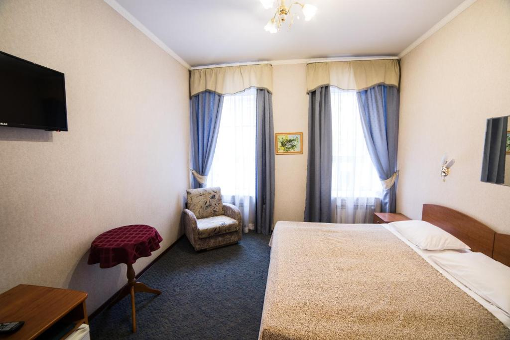 Кровать или кровати в номере Амулет на Большом