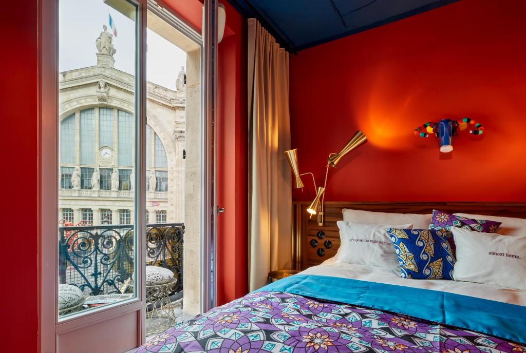 A bed or beds in a room at 25hours Hotel Terminus Nord
