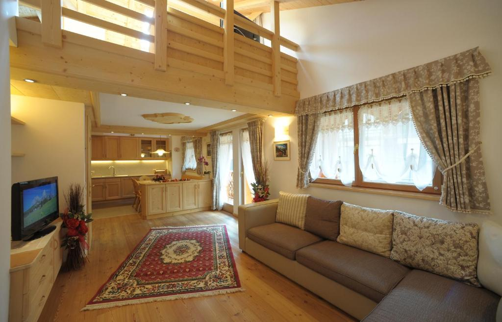 A seating area at Romantic Chalet Dolomiti