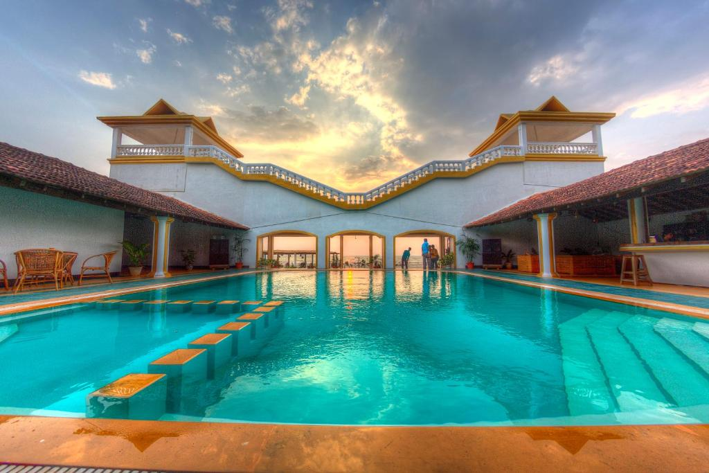 The swimming pool at or near Beach Street Eco Resort & Spa
