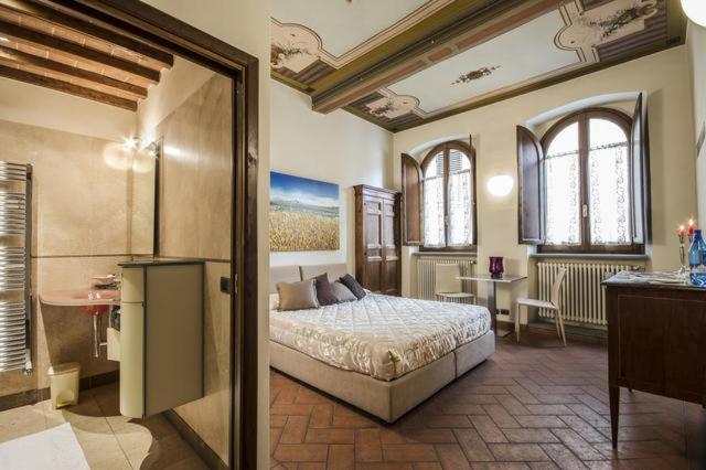 Cama ou camas em um quarto em La Corte Del Re