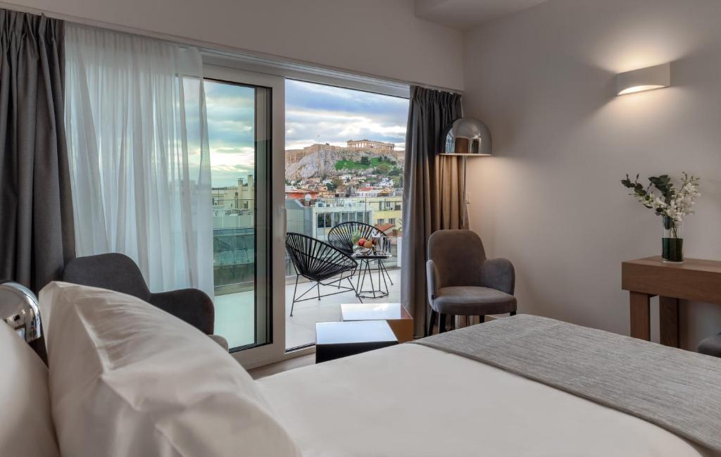 מיטה או מיטות בחדר ב-Elia Ermou Athens Hotel