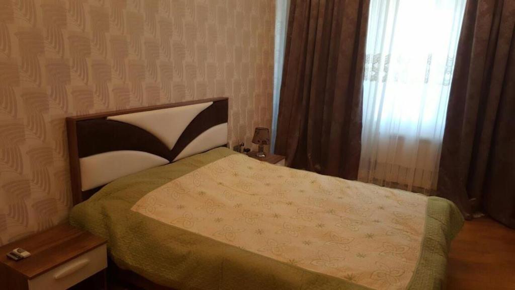Cama ou camas em um quarto em Winter Garden Apartment