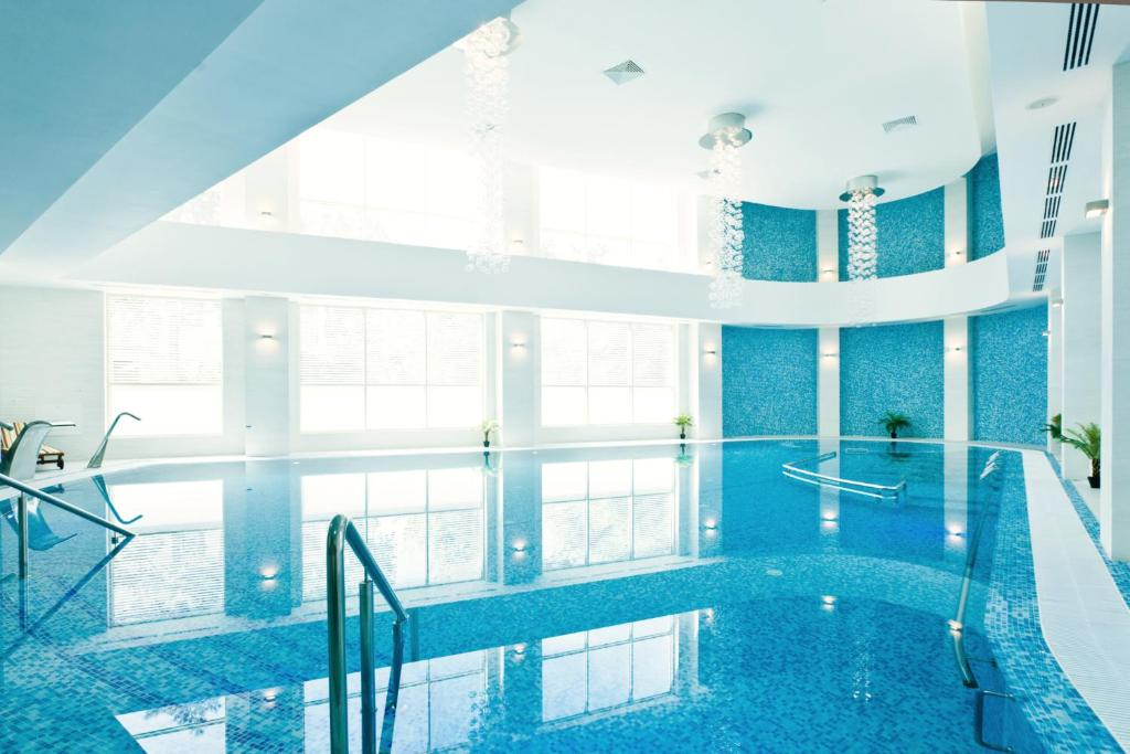 The swimming pool at or near Mirage Medspa Hotel
