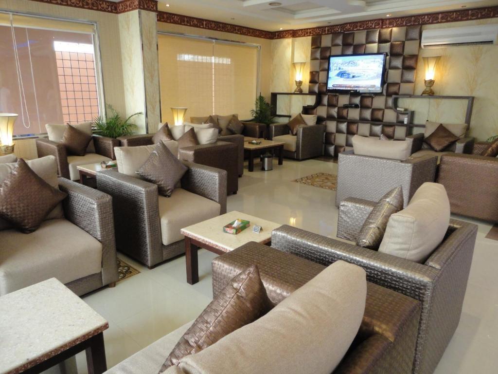 O lounge ou bar de فيناس للشقق الفندقية