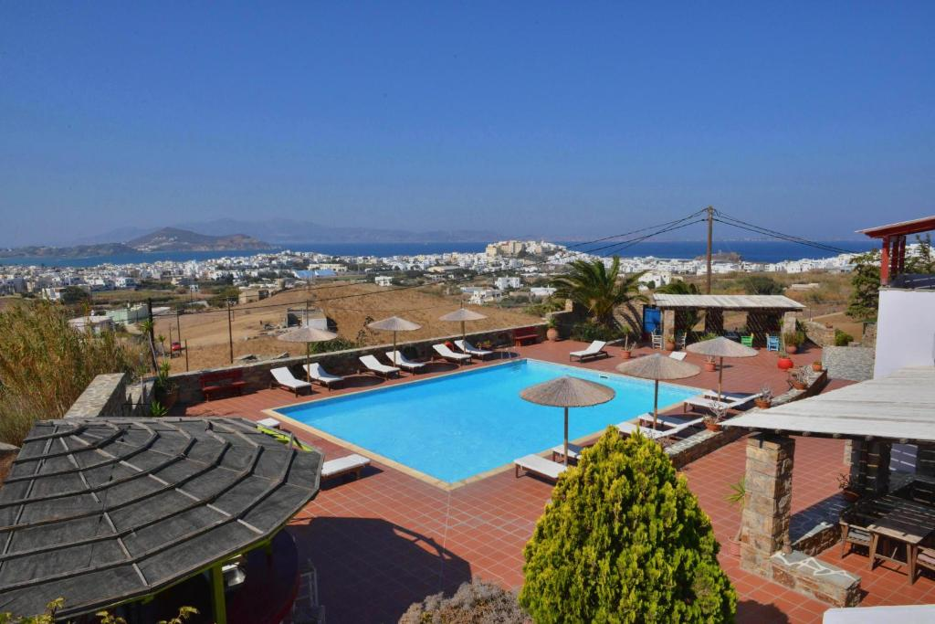 A view of the pool at Paradisia Villas or nearby