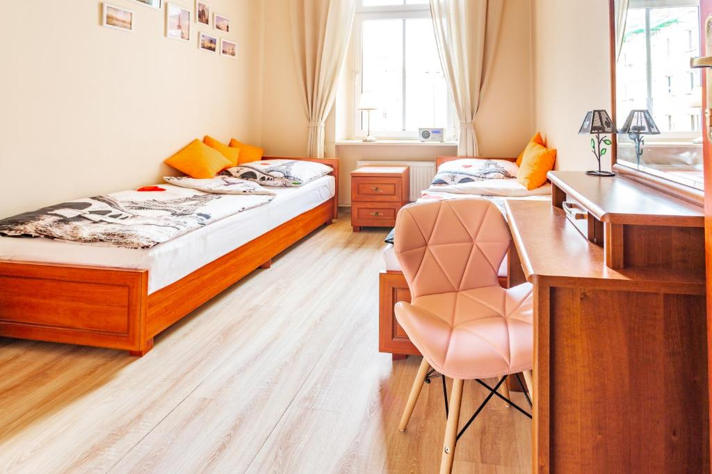 A bed or beds in a room at Babel Hostel
