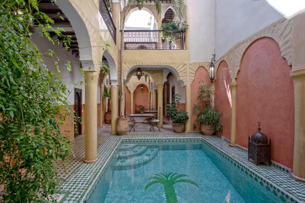 The swimming pool at or near Riad Itrane