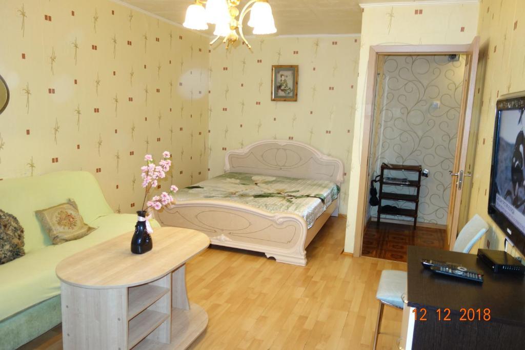 Кровать или кровати в номере Apartment on Voskresenskaya 9