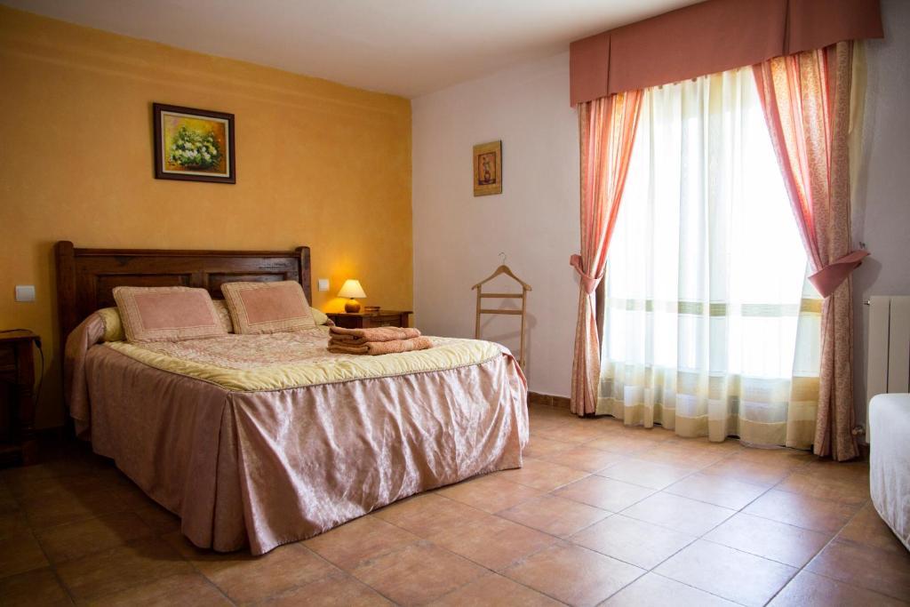 Cama o camas de una habitación en Casa Rural Julian