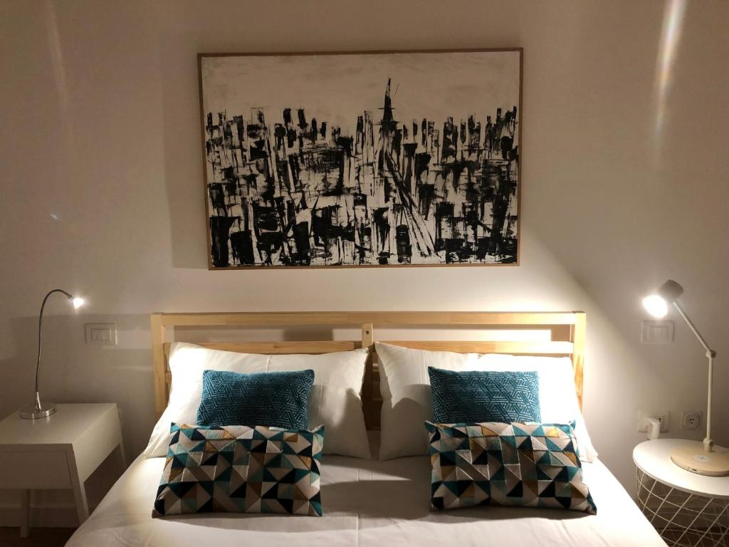 A bed or beds in a room at Residenza d'artista