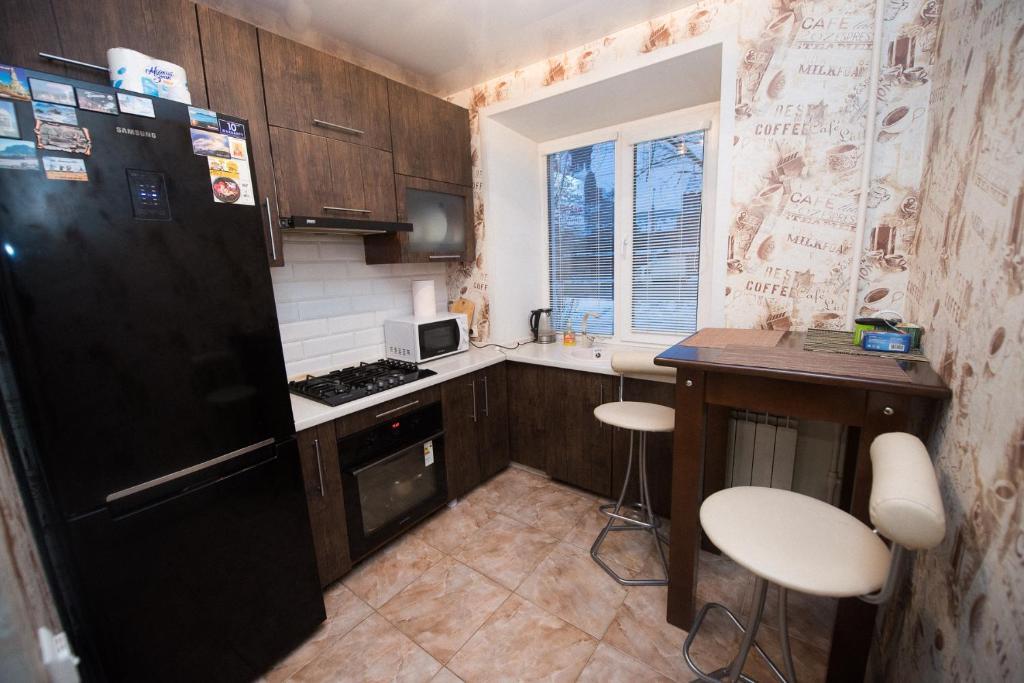 Кухня или мини-кухня в Апартаменты на Шереметевском