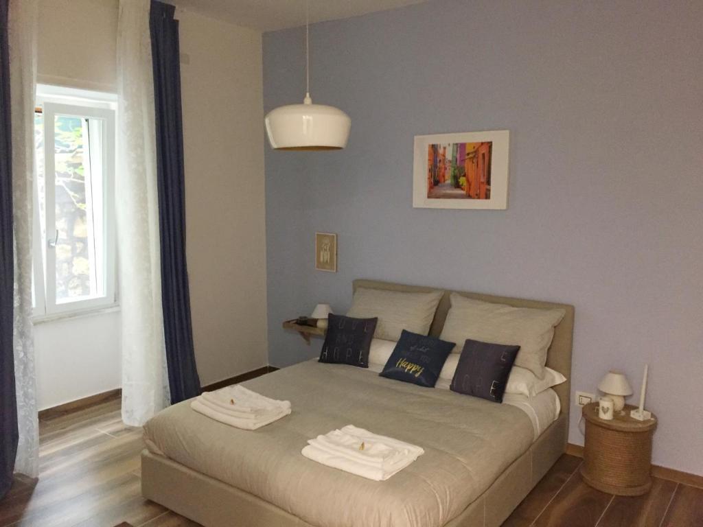 A bed or beds in a room at La casa di Alice