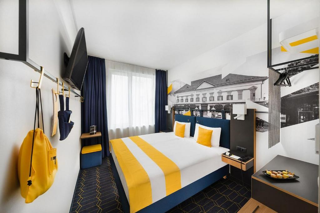 A bunk bed or bunk beds in a room at D8 Hotel