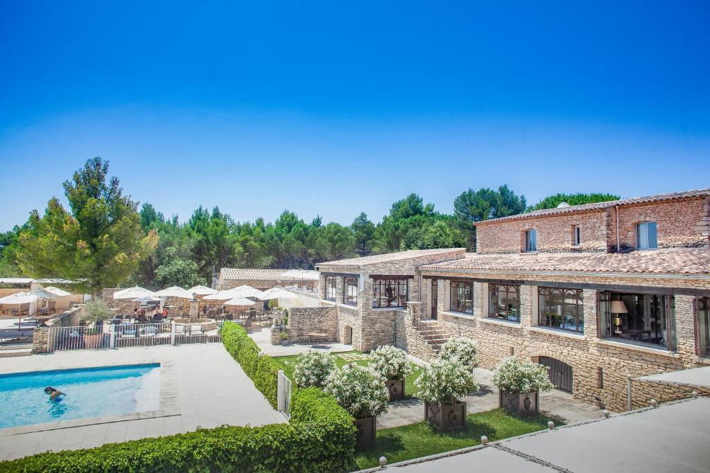 A view of the pool at Le Phébus & Spa – Relais & Châteaux or nearby