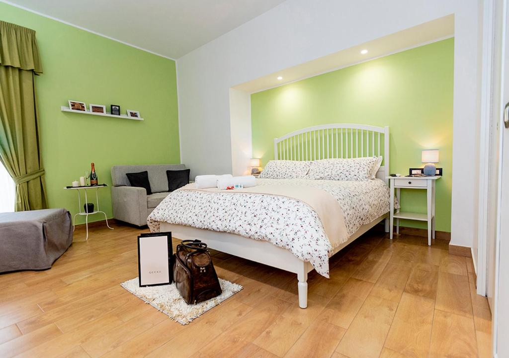 Letto o letti in una camera di B&B Vico Milano 18