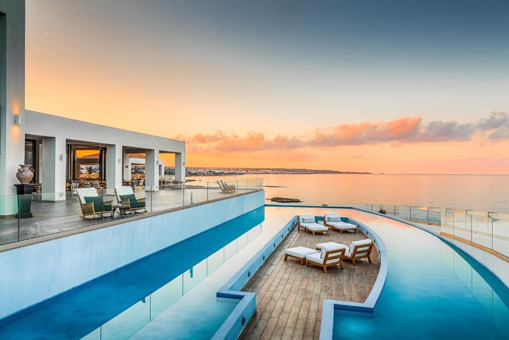 The swimming pool at or near Abaton Island Resort & Spa